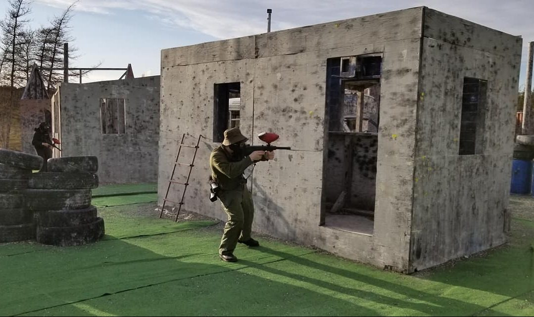 Someone playing paintball outside.