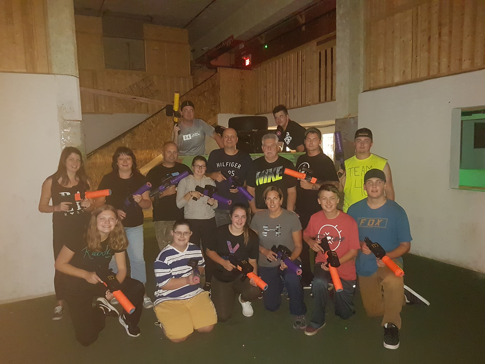 A group of people playing laser tag.